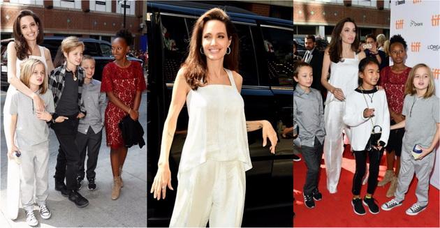 Анџелина Џоли во бел сатенски комбинезон  со шесте деца на Филмскиот фестивал во Торонто