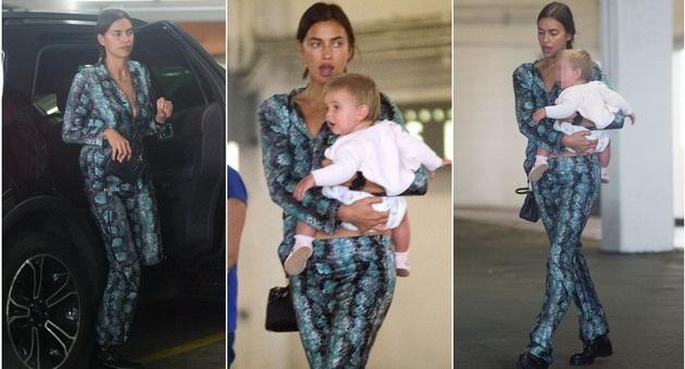 Ирина Шајк облечена во змиски дезен ја прошета ќеркичката Леа